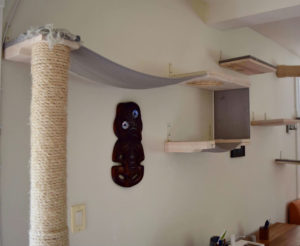 A wall mounted scratching post that makes up part ofa larger climbing system