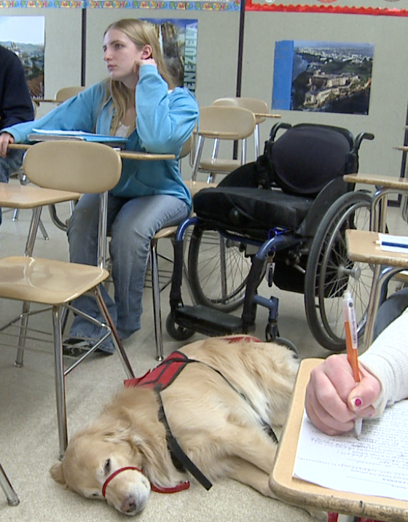 Erica and Baker, a mobility service dog trained by NEADS. This team works independently at Erica's school.