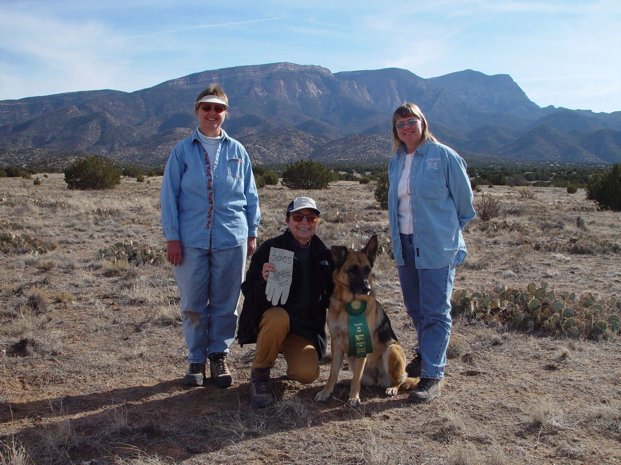 Ruby and I (center) after achieving her Tracking Dog title. I knew she was smart enough to learn skateboarding!