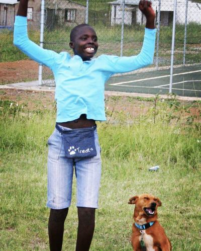 A happy child in a dog training class