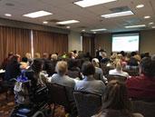 Mychelle Blake presenting a session on social media